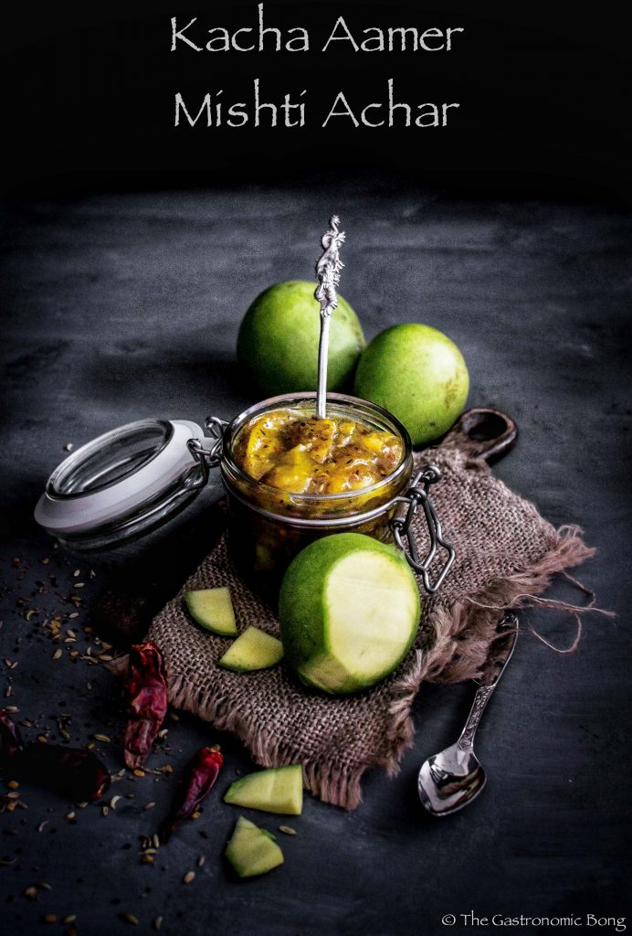 tok mishti jhal kacha aamer achar (sweet, spicy and tangy raw mango pickle)